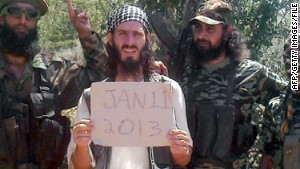 Omar Hammami, a U.S.-born Islamist operating in Somalia, holds a sign showing the date in a propaganda video.