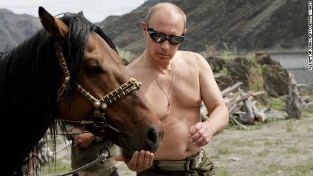 "Putin vacations outside the town of Kyzyl in Southern Siberia in 2009. Over the years he has earned <a href='http://www.cnn.com/2012/03/02/europe/gallery/cult-of-vladimir-putin/index.html'>a reputation as a ""strongman,""</a> declaring a crackdown on Chechen militants a priority in his first presidential term."