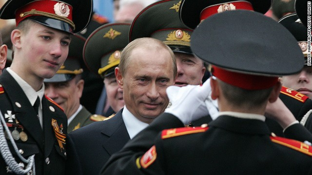 A Russian cadet snaps a picture with Putin in Moscow's Red Square on May 9, 2007, during an annual celebration of the end of Wor