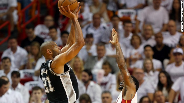 Tim Duncan of the San Antonio Spurs shoots over Miami's Udonis Haslem.