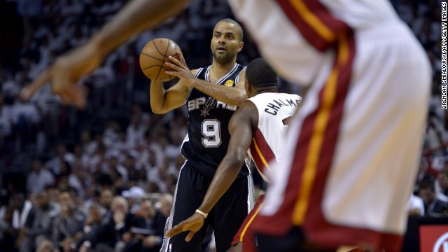 Tony Parker of the San Antonio Spurs is guarded by Mario Chalmers of the Miami Heat.