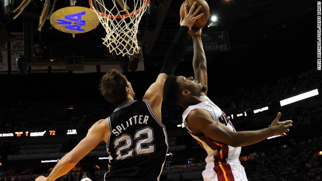 Norris Cole of the Miami Heat goes up for a shot against Tiago Splitter of the San Antonio Spurs.