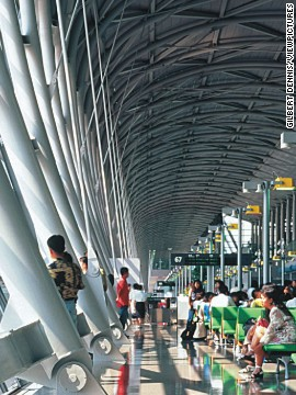 Passengers wait in the terminal building at Kansai International Airport, completed in 1994.