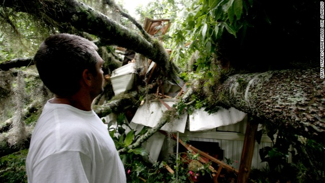 David Anthony Reynolds checks out a tree that fell on his Gainesville, Florida, house as a result of Tropical Storm Andrea on Thursday, June 6. Tropical Storm Andrea is expected to drench 13 U.S. states from Georgia to Maine.