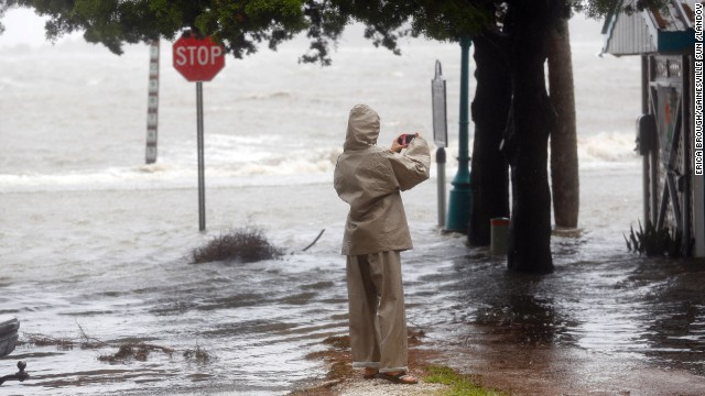 Robin Kessel takes photos as Tropical Storm Andrea arrives in Cedar Key on June 6.