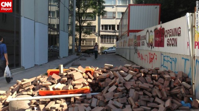 The same anonymous<a href='http://ireport.cnn.com/docs/DOC-982570'> iReporter</a> observed this street barricaded by protesters with bricks in Istanbul last Saturday. Turkish Prime Minister Recep Tayyip Erdogan has called for an end to the protests against his government.