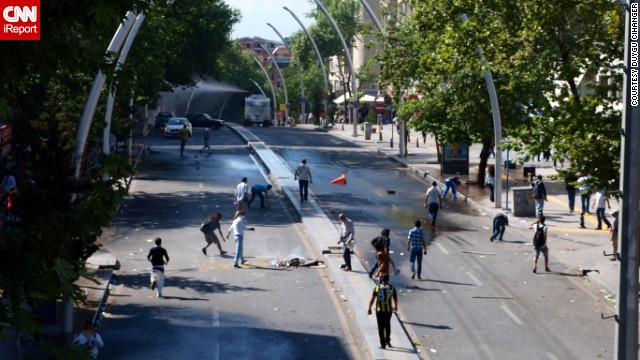 In the Turkish capital, Ankara, Saturday, iReporter <a href='http://ireport.cnn.com/docs/DOC-981195'>Duygu Cihanger</a> shot scenes of protesters ahead of what appears to be a police van firing a water cannon.