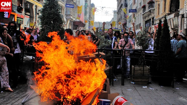 <a href='http://ireport.cnn.com/docs/DOC-981786'>Görkem Keser</a> captured this Fiery scene in Istanbul last Friday as protesters chant.