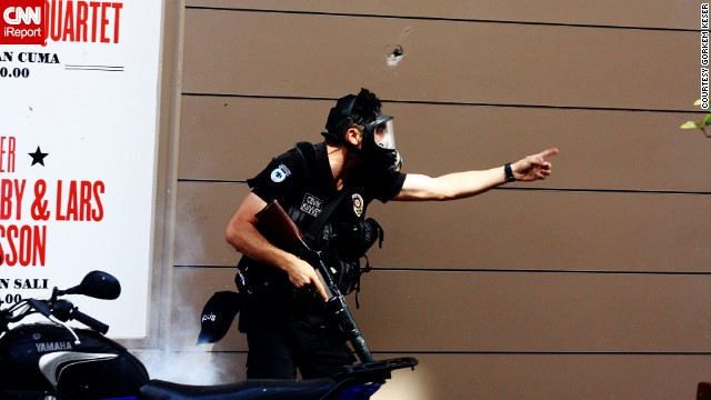 <a href='http://ireport.cnn.com/docs/DOC-981786'>Görkem Keser </a>also shot this photo of a police officer amid protests in Istanbul last Friday.