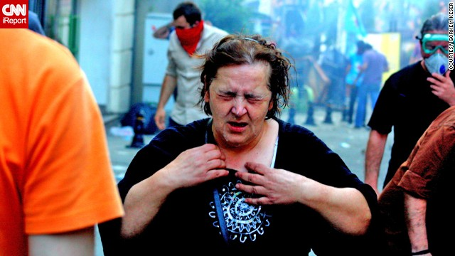 Police have used tear gas, or pepper spray, at some demonstrations. iReporter <a href='http://ireport.cnn.com/docs/DOC-981786'>Görkem Keser </a>captured this image of a woman suffering effects of the gas.