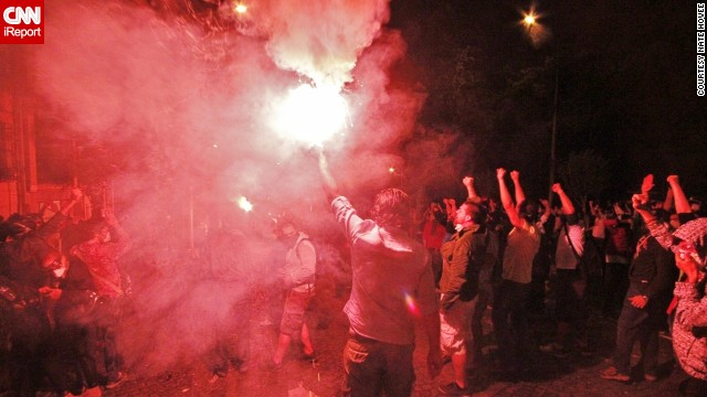 Cities in Turkey have been rocked by days of anti-government protests. This image by iReporter <a href='http://ireport.cnn.com/docs/DOC-982924'>Nate Hovee</a> from Sunday shows protesters chanting and surrounding a flare in Istanbul.