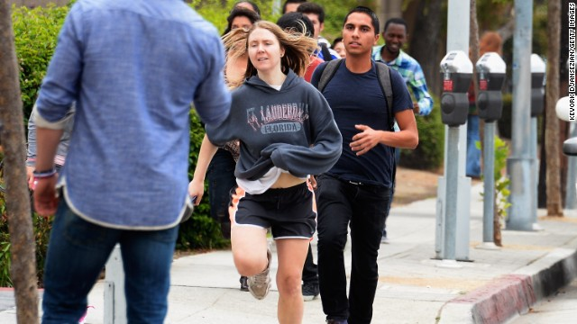 Students rush to safety after shots were fired.