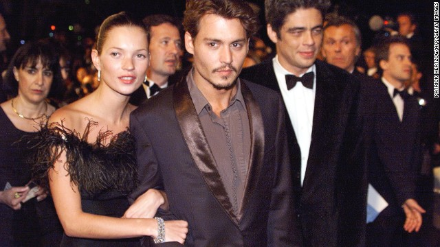 While known to shy away from most interviews, Moss' private life has inevitably remained the subject of heated speculation and intrigue. Her four-year relationship with film star Johnny Depp, which ended in 1998, was irresistible camera fodder.