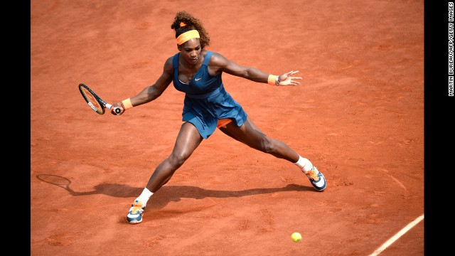 Williams returns a shot to Sharapova.
