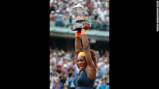 Williams celebrates with the Coupe Suzanne Lenglen trophy following her victory.
