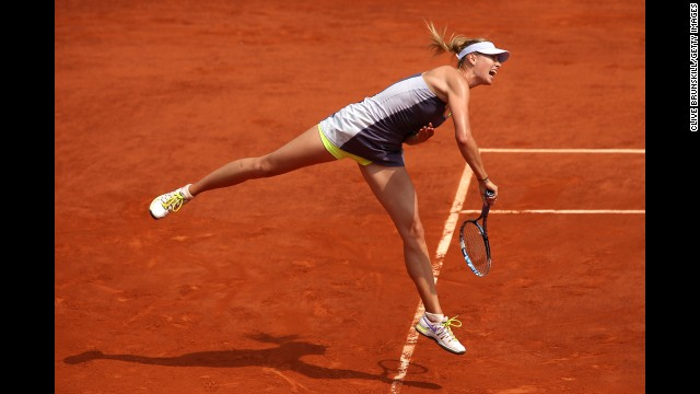 Sharapova serves against Williams.