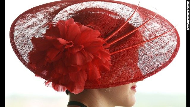 A woman wearing a red hat attends the races on June 8.