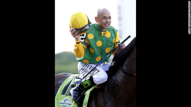 Jockey Mike E. Smith celebrates after riding Palace Malice to victory.