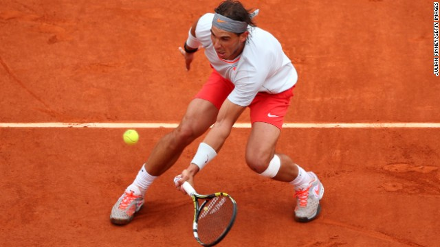 Rafael Nadal of Spain plays a forehand against David Ferrer of Spain during the men's singles final match of the French Open at Roland Garros Stadium in Paris, on Sunday, June 9.