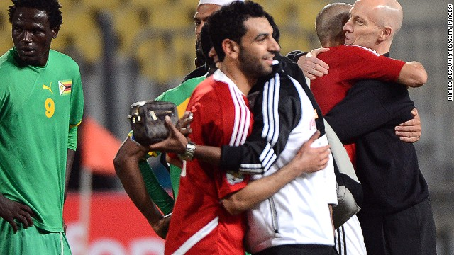 Mohamed Salah is congratulated by the Egpyt coaching staff after his hat-trick in the win over Zimbabwe