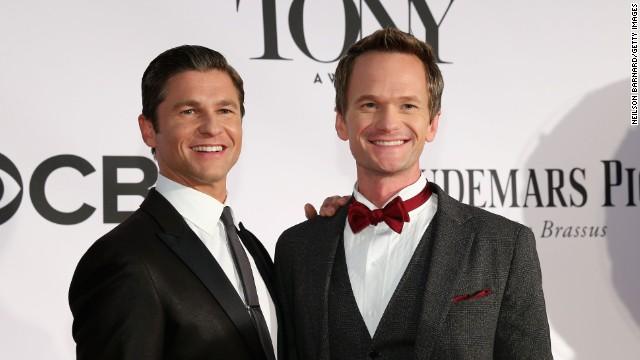 Host Neil Patrick Harris, right, and David Burtka hit the red carpet.