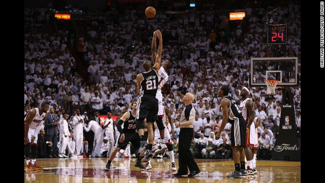 Tim Duncan of the San Antonio Spurs and Chris Bosh of the Miami Heat go for the jump ball at the start of Game 2.