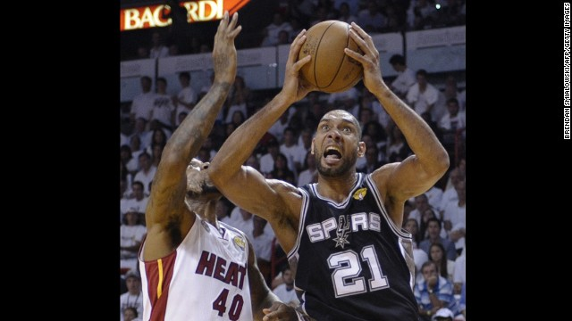 Tim Duncan of the San Antonio Spurs goes to the basket against Udonis Haslem of the Miami Heat during Game 2.