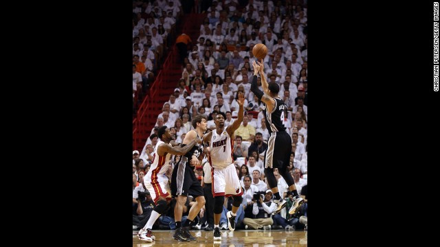 Danny Green of the San Antonio Spurs makes a three-pointer over Chris Bosh of the Miami Heat in the first quarter.