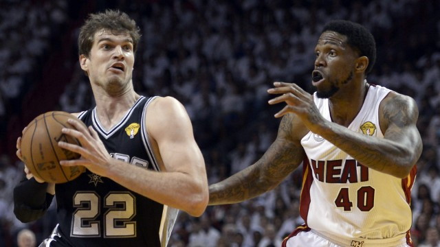 Tiago Splitter of the San Antonio Spurs drives to the basket against Udonis Haslem of the Miami Heat.