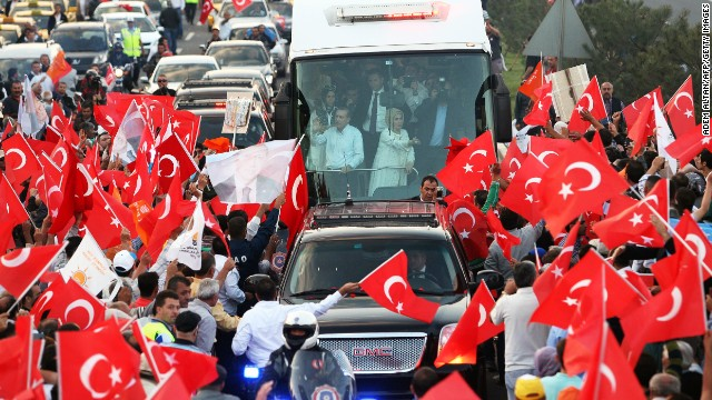 "Turkish Prime Minister Recep Tayyip Erdogan, left, and his wife, Emine, wave to supporters upon their arrival in Ankara on June 9. Erdogan told supporters that ""even patience has an end"" as he went on the offensive against mass protests that have consumed Ankara and Istanbul."