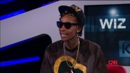 Rapper Wiz Khalifa talks about working with his idol, Snoop Dogg, and admits he's been busted for pot more than 18 times.