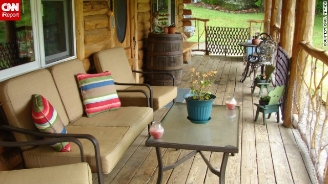 <a href='http://ireport.cnn.com/people/thepizzaman'>iReporter Paul Tamasi </a>says he enjoys roughly three hours each day on his rustic front porch in Belvidere, Vermont. It's part of the massive renovation he conducted on his home, turning it into a log cabin with a grand entrance.