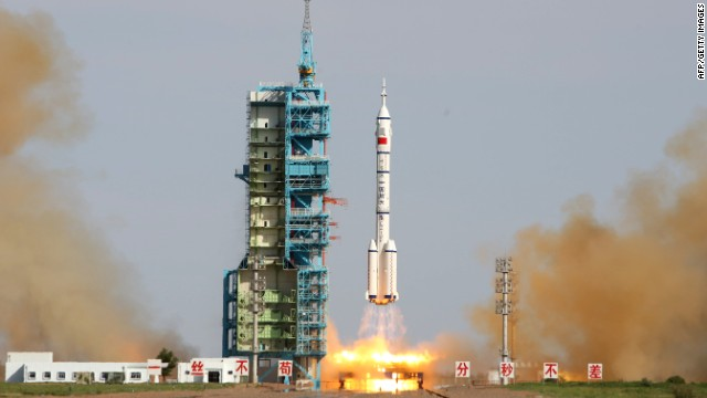 Photos: China launches three into space