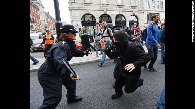 A protester tries to evade a police officer in Soho on June 11.