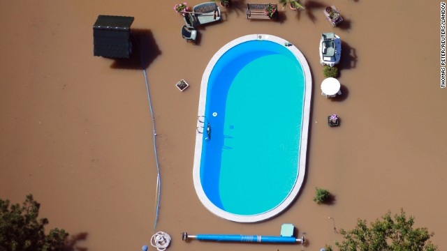 Floodwaters from the Elbe River inundate a yard with a swimming pool near Magdeburg, Germany, on Monday, June 10. Heavy rain has left rivers swollen across Central Europe.
