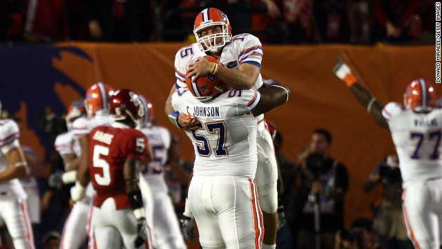 Tebow celebrates with teammate Carl Johnson, No. 57, after throwing for a touchdown in the 2009 BCS National Championship game against the Oklahoma Sooners. The Gators won 24-14.