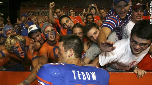 Fans greet Tebow after the Gators defeated the Southern Miss Golden Eagles at Ben Hill Griffin Stadium in Gainesville, Florida, on September 2, 2006. He rushed for a touchdown in the first play of his college career.