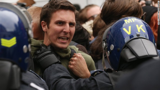 Police hold off protesters in London's Golden Square on June 11.