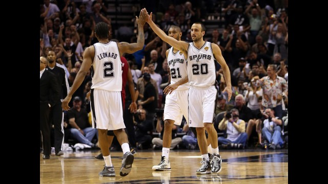 Manu Ginobili, right, congratulates Kawhi Leonard of the San Antonio Spurs after scoring during the first half.