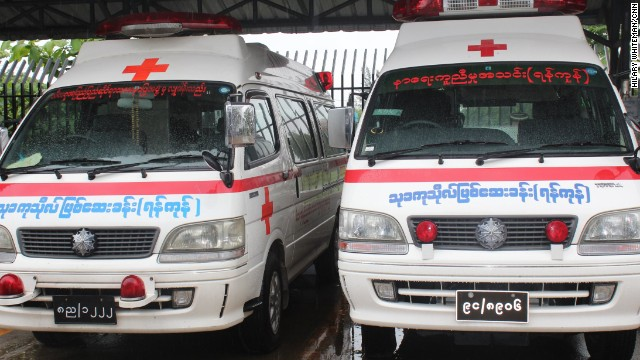 Ambulances are parked at the society's Yangon headquarters. When Burmese people need urgent care they phone Kyaw Thu. Locals say an official 911 emergency line was introduced but it's not something they can rely on for urgent help.