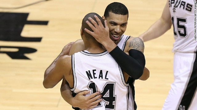Danny Green of the San Antonio Spurs celebrates with teammate Gary Neal as they take on the Miami Heat during Game 3 of the 2013 NBA Finals on Tuesday, June 11, in San Antonio. The Spurs defeated the Heat 113-77 and lead the series 2-1. See photos from Game 2.