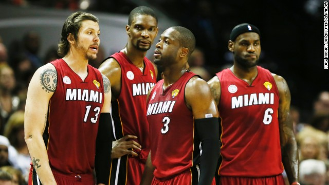 From left, Miami Heat's Mike Miller, Chris Bosh, Dwyane Wade and LeBron James talk during a break in the game.