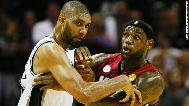 San Antonio's Tim Duncan and Miami's LeBron James battle for position.