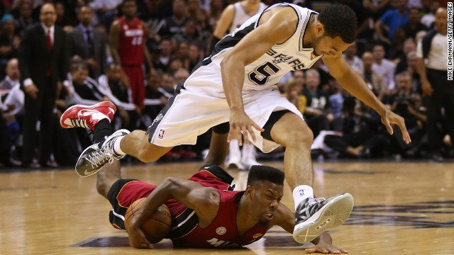 Cory Joseph of the San Antonio Spurs and Norris Cole of the Miami Heat go after a loose ball in the second half.