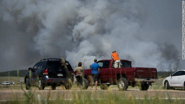 Motorists stop along Interquest Parkway in Colorado Springs on June 11 to watch the advance of a wildfire burning in the Black Forest.