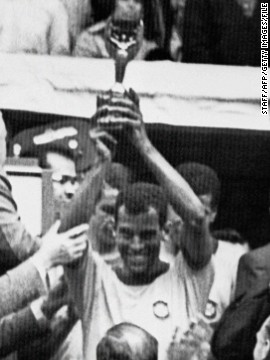 Carlos Alberto, captain of the 1970 team, lifts the Jules Rimet trophy which Brazil was allowed to keep after becoming the first nation to win the World Cup three times. The former fullback thinks next year's World Cup will come too soon for Brazil's inexperienced team.