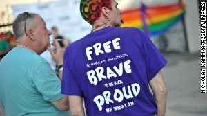 Men attend the 2013 Capital Pride parade in Washington on June 8\n