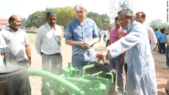 Professor Anil Gupta shows Hollywood film director James Cameron a biomass gasifier invented by Raj Singh Dahiya. Dahiya was born into humble circumstances, but taught himself engineering from a young age. The gassifier -- developed over 20 years -- creates fuel from farm waste bringing power to otherwise isolated areas of the country to light houses, filter water, and run mills.