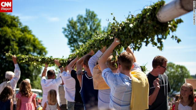 In Sweden, where Midsummer is one of the biggest celebrations of the year, singing and dancing are central to the fun and frolics. But before all that the maypole has to be decorated and raised. <a href='http://ireport.cnn.com/people/ulfbodin' target='_blank'>Ulf Bodin</a> took this photo in the small town of Sigtuna, an hour north of Stockholm.