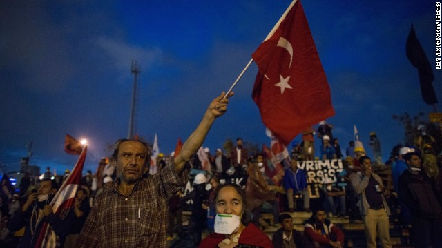 A man waves a flag in Taksim Square on June 12.